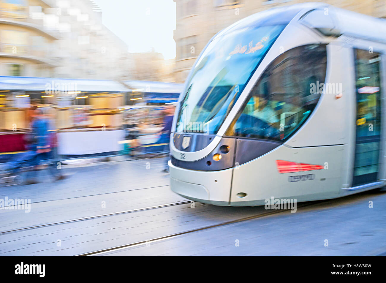 The tram in motion,  riding along the Yafo Road - Stock Image