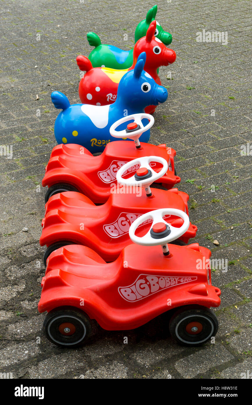 toys, bobby car, bouncy horse, made of plastic, ready, waiting at a kids birthday party, Stock Photo