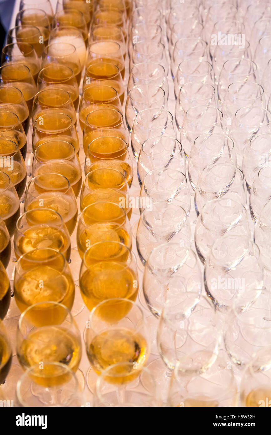 Champagne glasses, filled for the guest of an event, - Stock Image