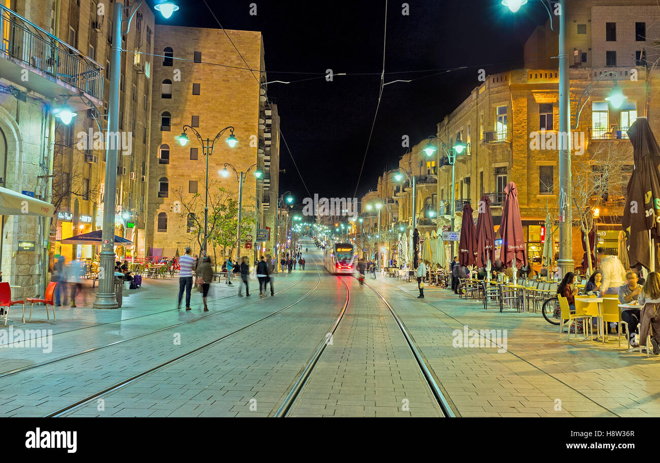 The evening makes the Jaffa Road best place to spend the time in cozy outdoor cafe or restaurant of local cuisine - Stock Image