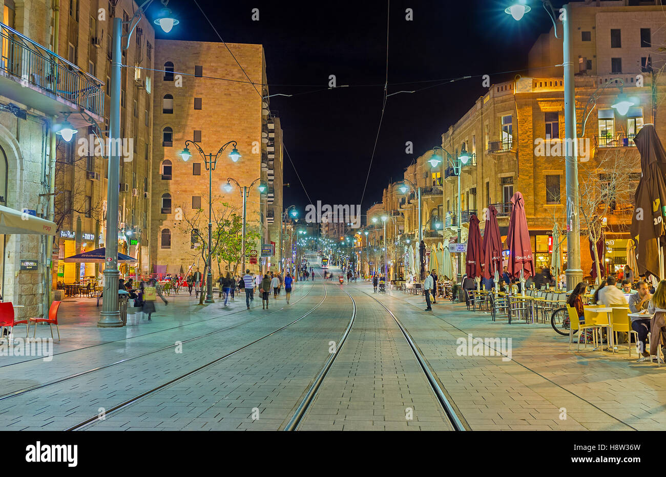 The pleasant walk in the evening city along the railways of Jaffa Road - Stock Image