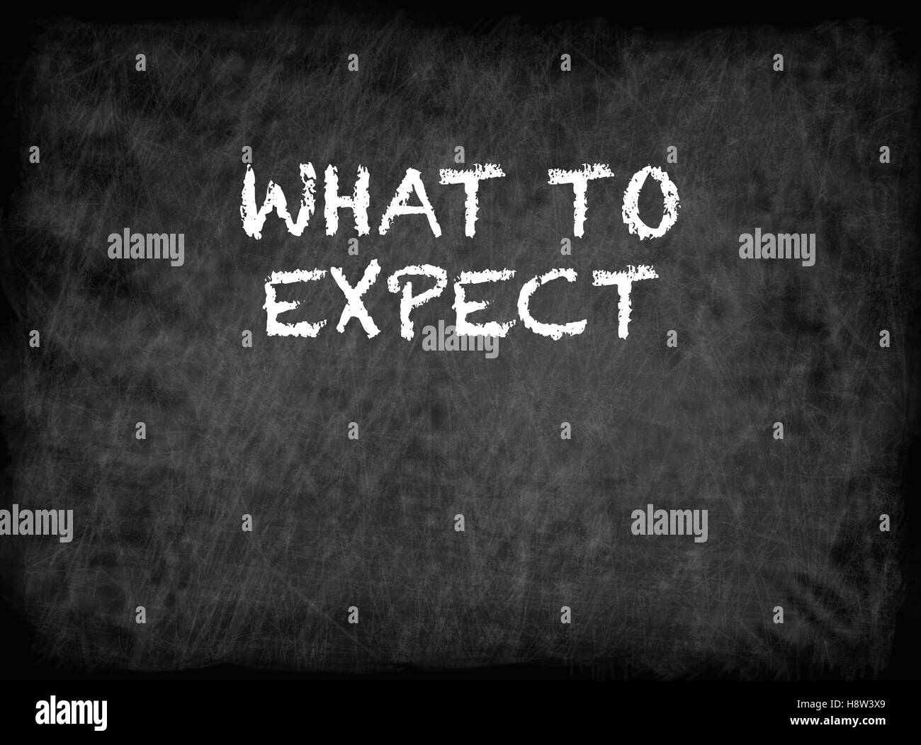 What To Expect - text on chalkboard - Stock Image
