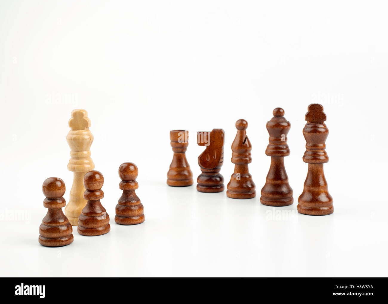 Chess pawns on a white background - Stock Image