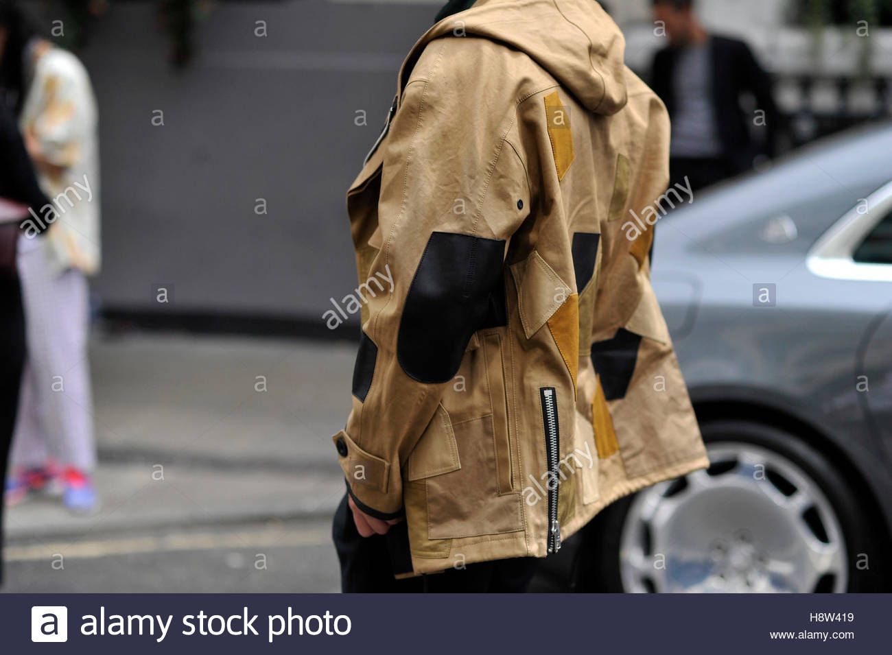 A detail of a mans jacket with patches at London Collections Men Fashion Week, on Great Queen Street, London. - Stock Image