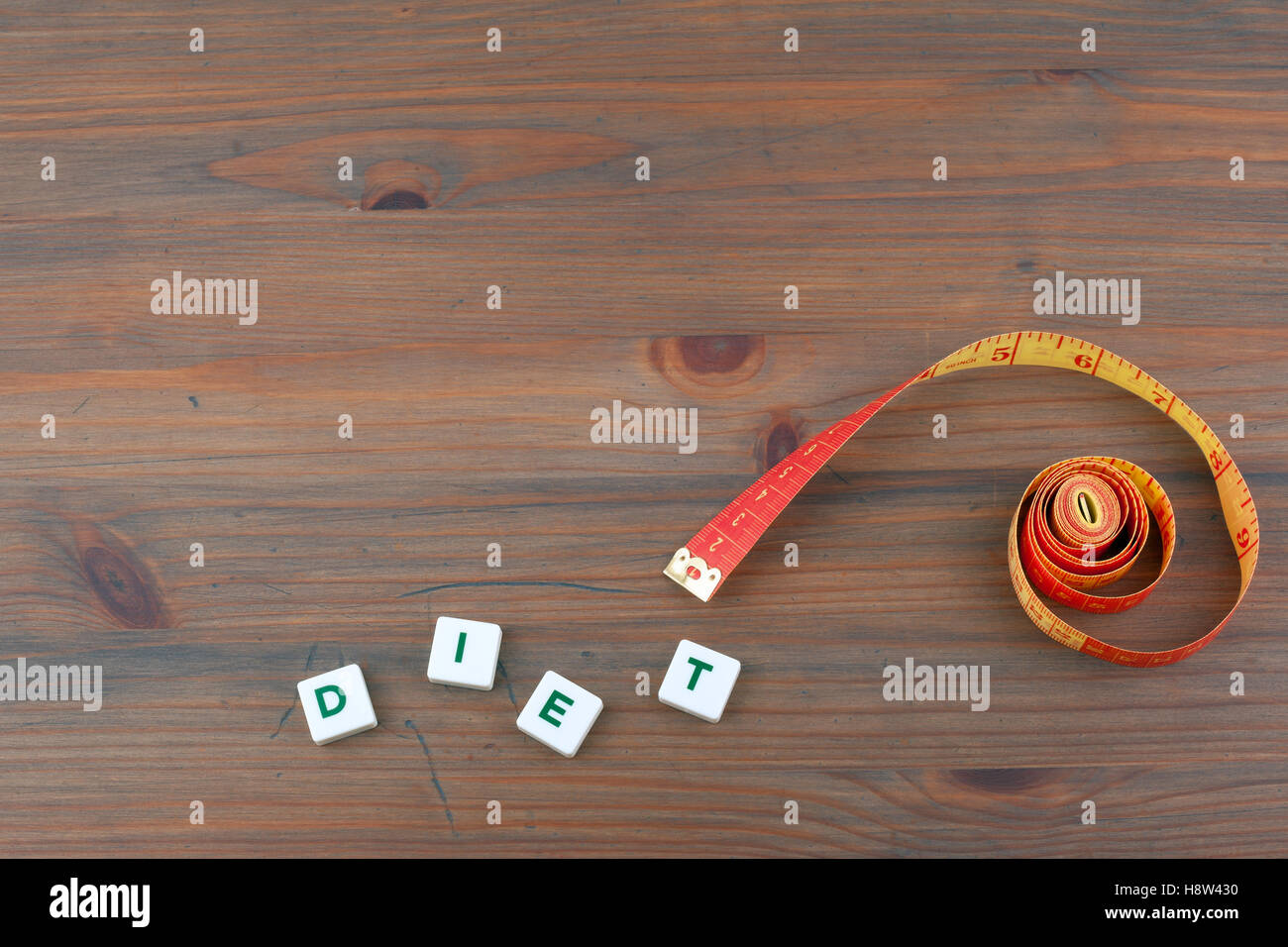 Metric measuring tape on a wooden background - Stock Image