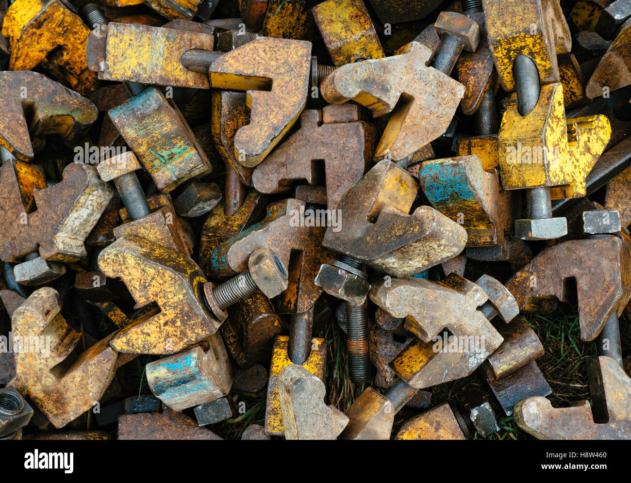 Pile of metal clamps used for rail track maintenance - Stock Image