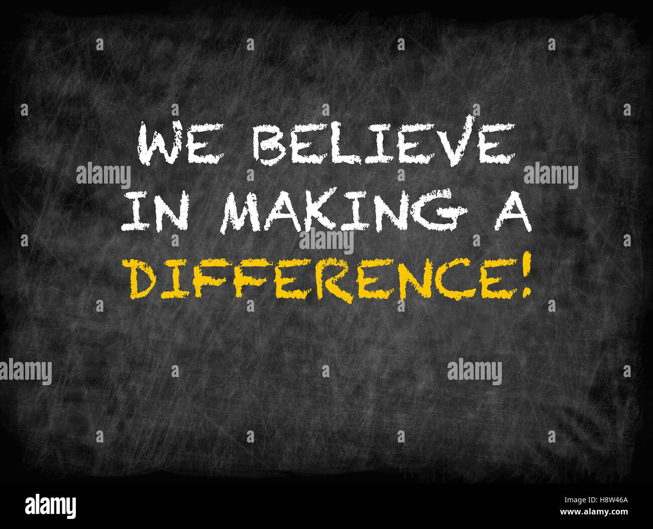 We believe in making a difference - text on chalkboard - Stock Image