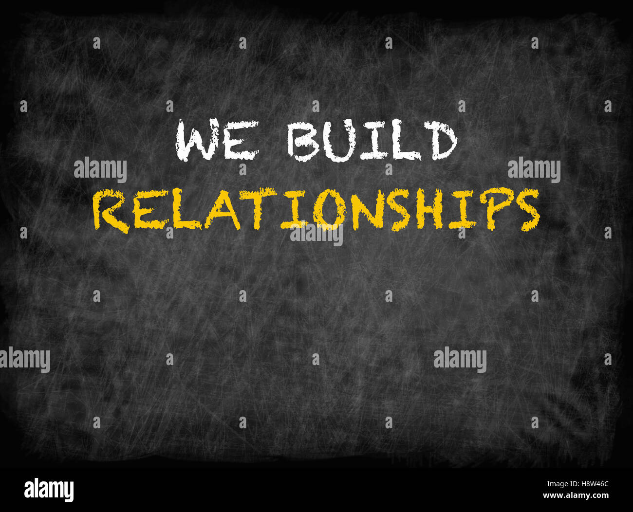 We Build Relationships - text on chalkboard - Stock Image