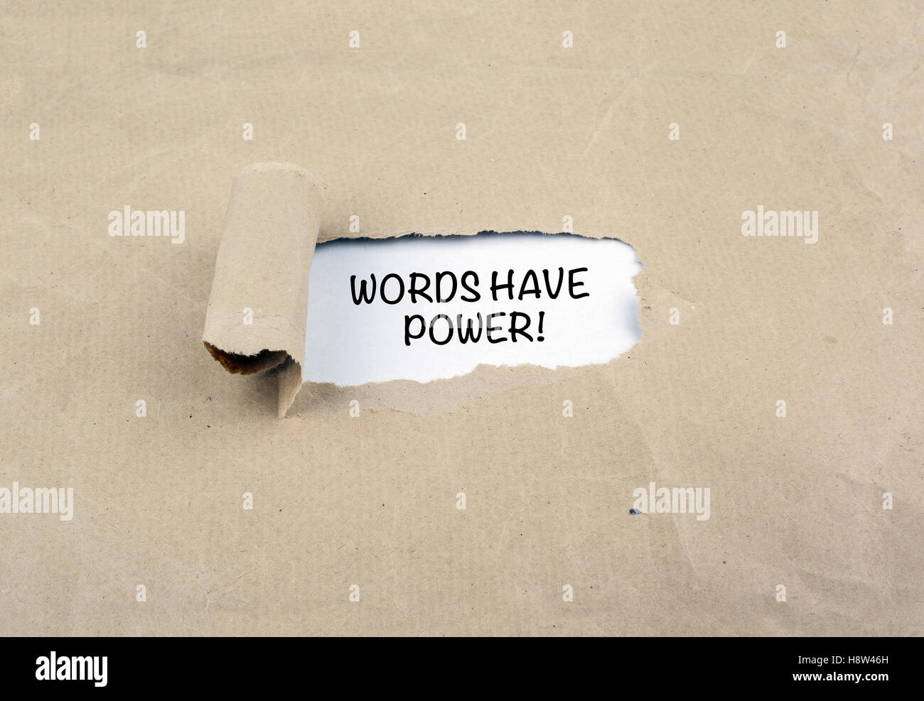 Inscription revealed on old paper - Words Have Power! - Stock Image