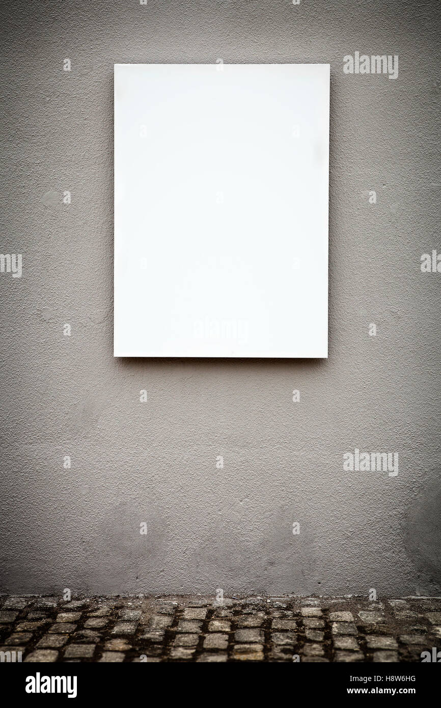 Blank Vertical White Board On Grungy Gray Wall - Stock Image