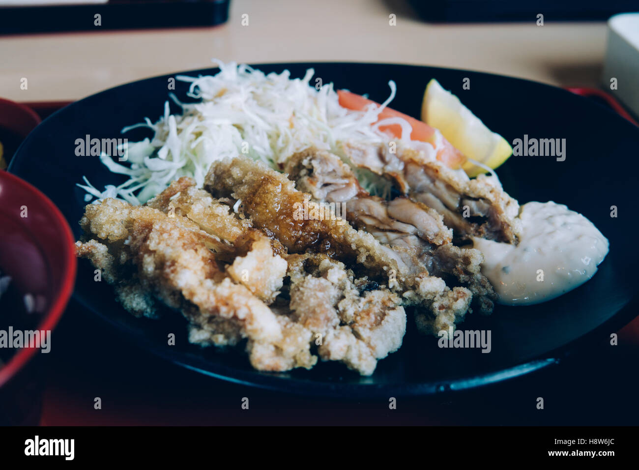 Japanese Style Dish: Fried Chicken and Salad with Miso Soup in retro filter hipster stylized effect - Stock Image