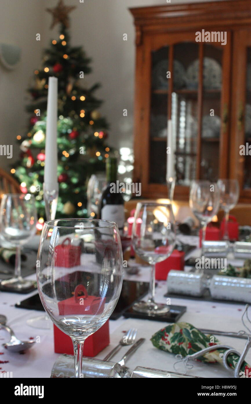 Table set up with crackers and candlesticks ready for Christmas lunch with a tree in the & Lunch Christmas Ready Table Set Stock Photos \u0026 Lunch Christmas Ready ...