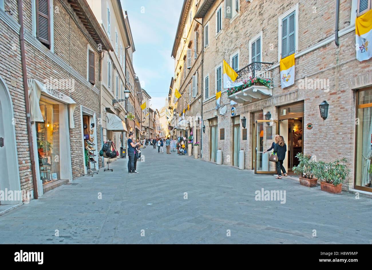 The central shopping street - Corso Traiano Boccalini, leads to Basilica of Santa Casa - Stock Image