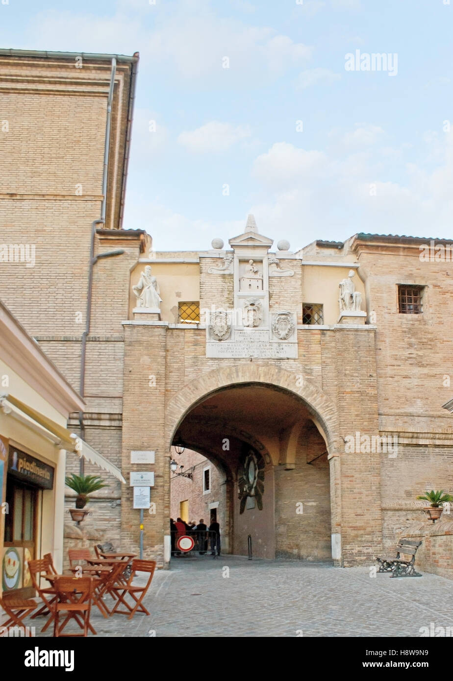 The brick Roman Gate (Porta Romana) decorated with white marble sculptures and reliefs and leads to the old town - Stock Image