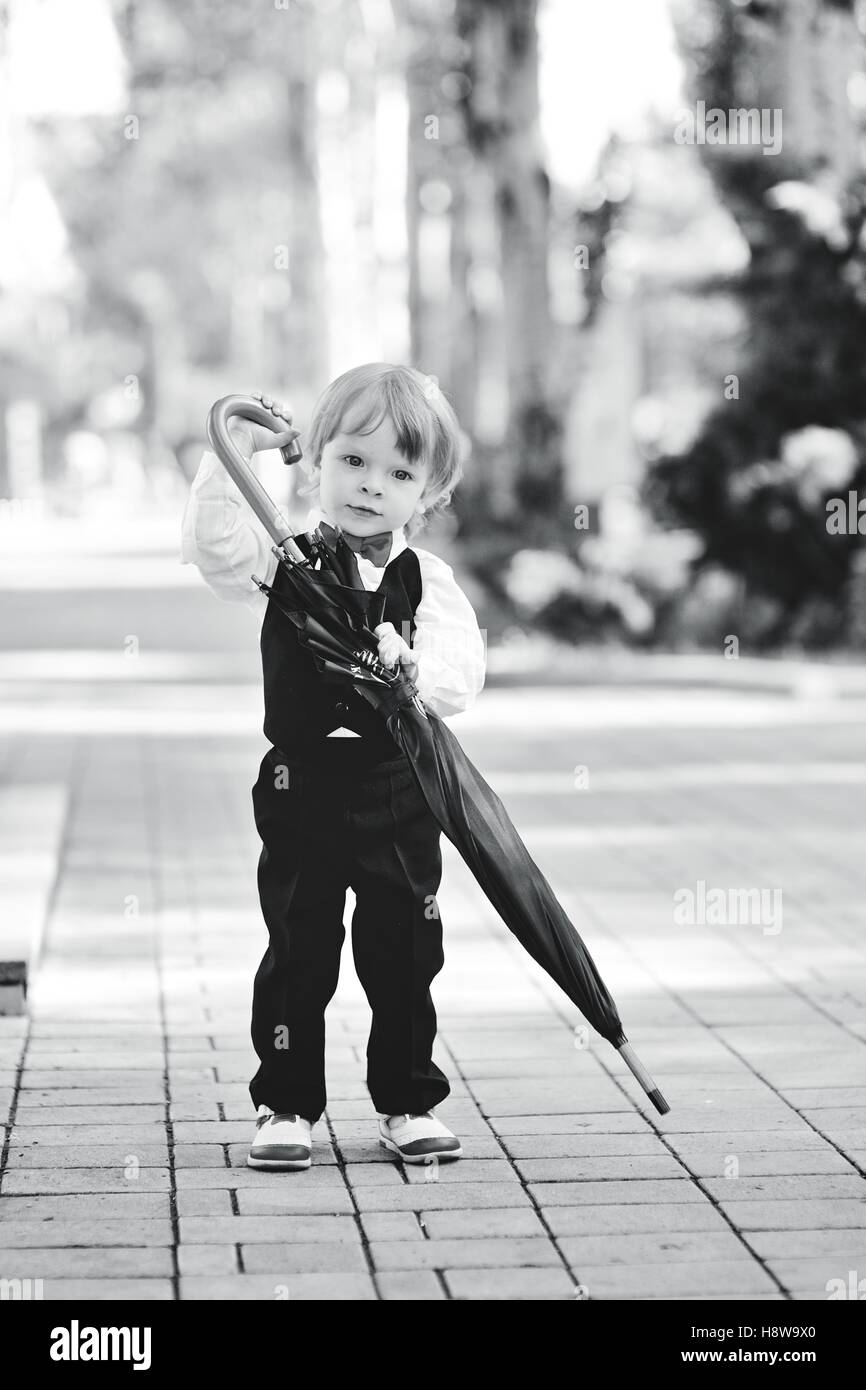 child with umbrella in hands - Stock Image