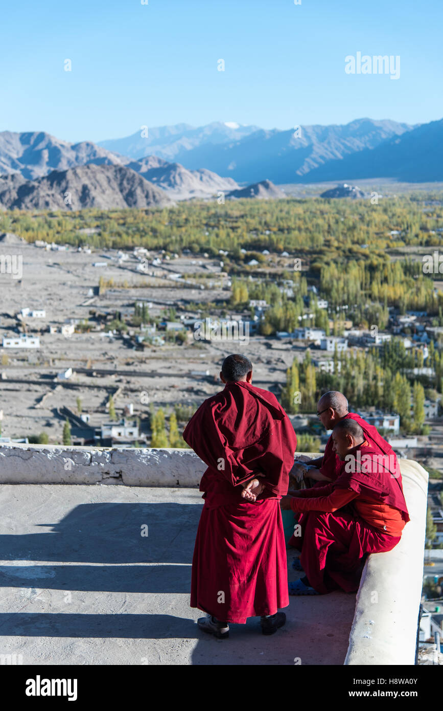 Monks sitting on top floor with beautiful Nature view. - Stock Image