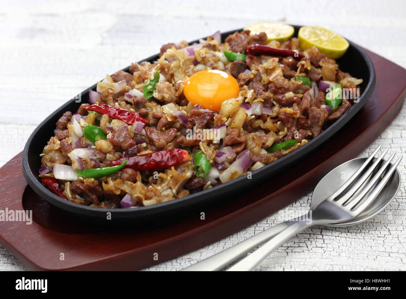 sizzling pork sisig, filipino cuisine - Stock Image