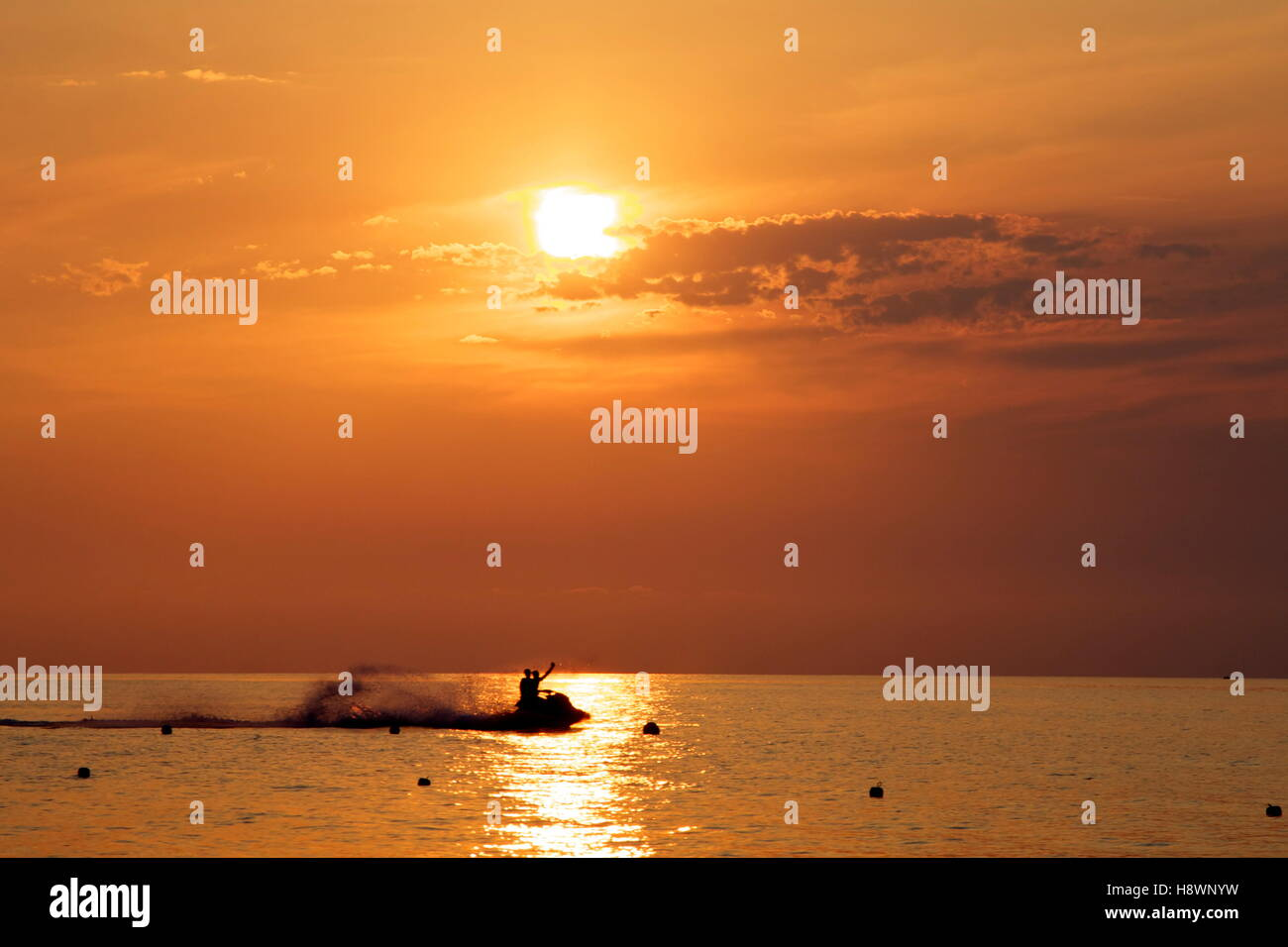 enjoying a watercraft during sunset on the coast of Tropea Calabria Italy - Stock Image