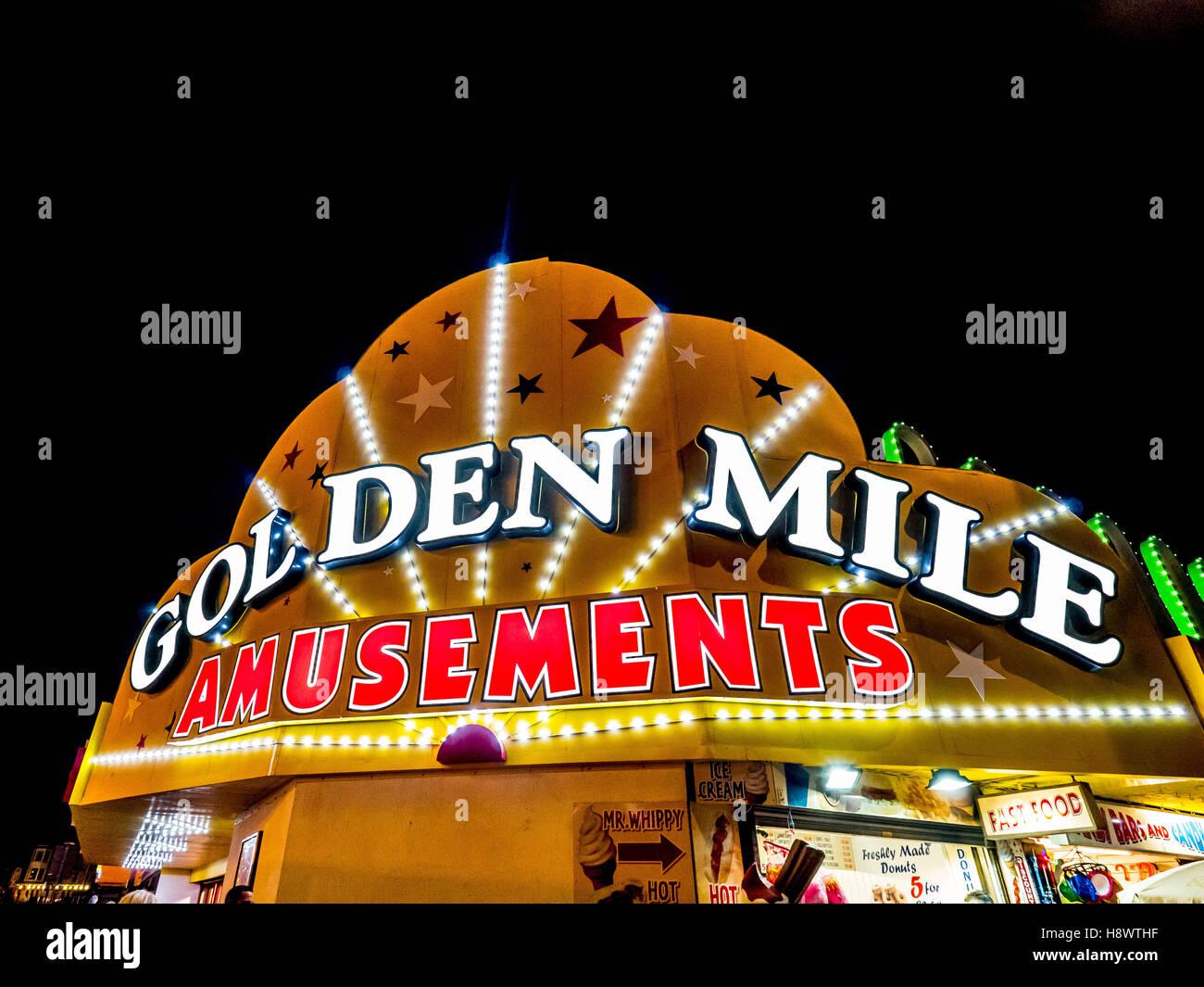 Golden Mile Amusements illumnated sign, Blackpool, Lancashire, UK. - Stock Image
