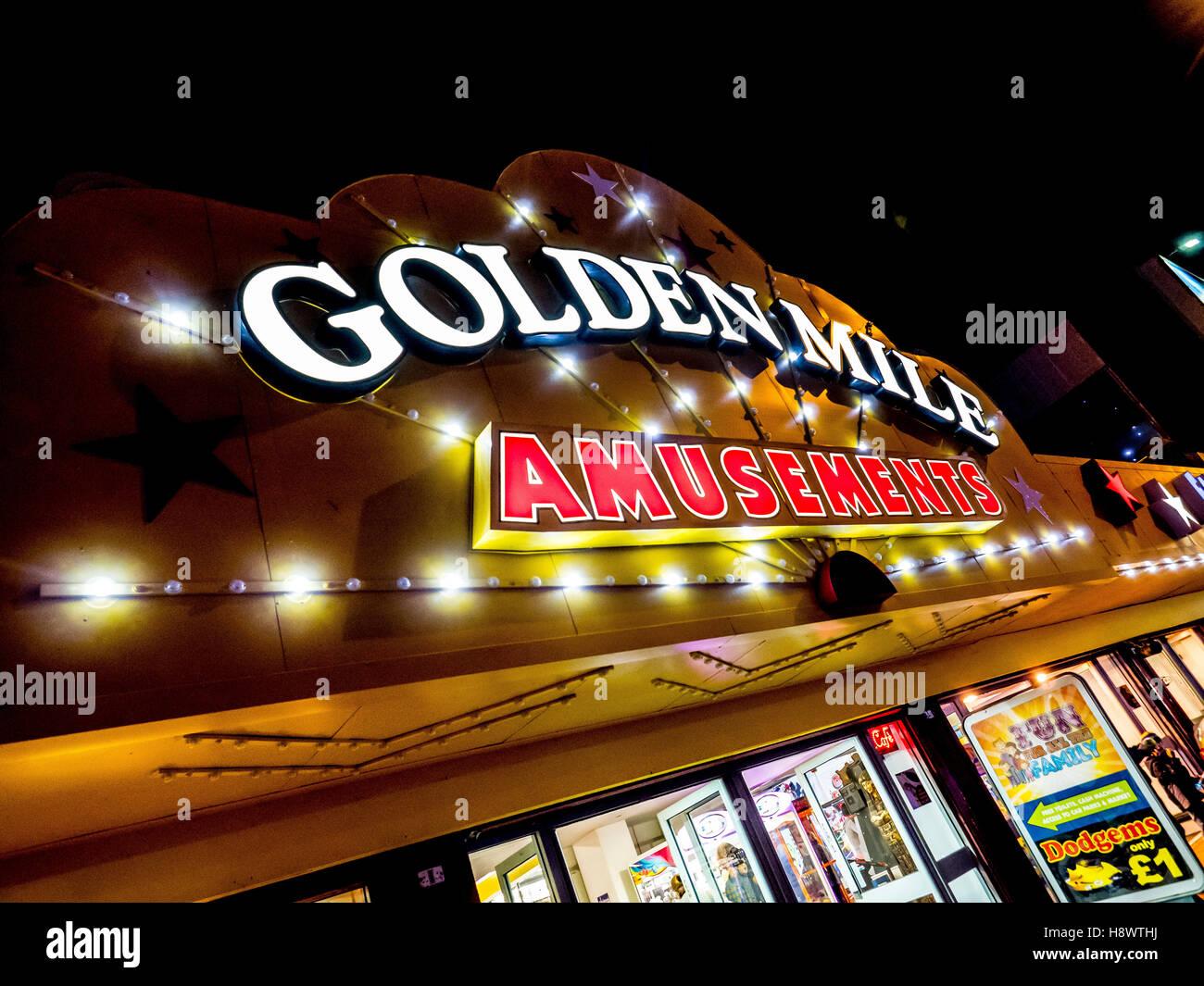 Golden Mile Amusements illuminated sign, Blackpool, Lancashire, UK. - Stock Image