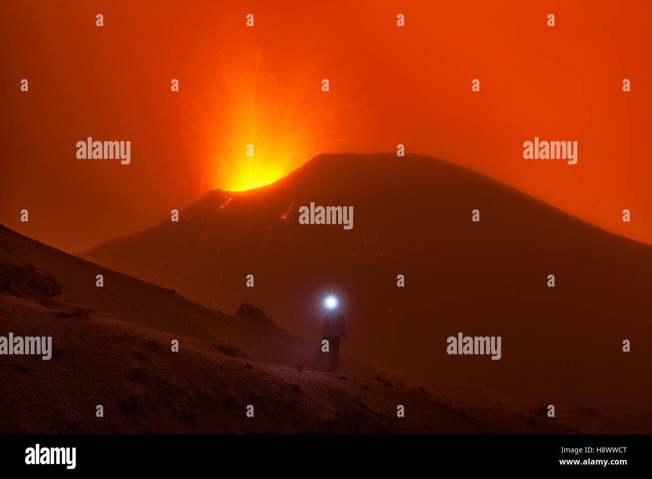 Volcanologist approach on Piton de la Fournaise in activity, Volcano eruption of May 2015, Reunion - Stock Image