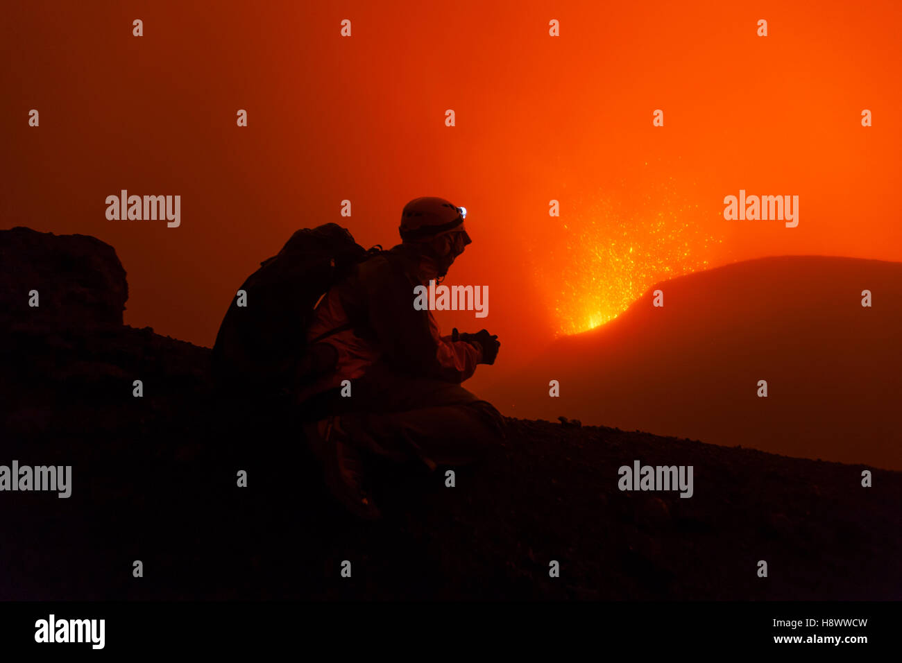 Volcanologist on Piton de la Fournaise in activity, Volcano eruption of May 2015, Reunion - Stock Image
