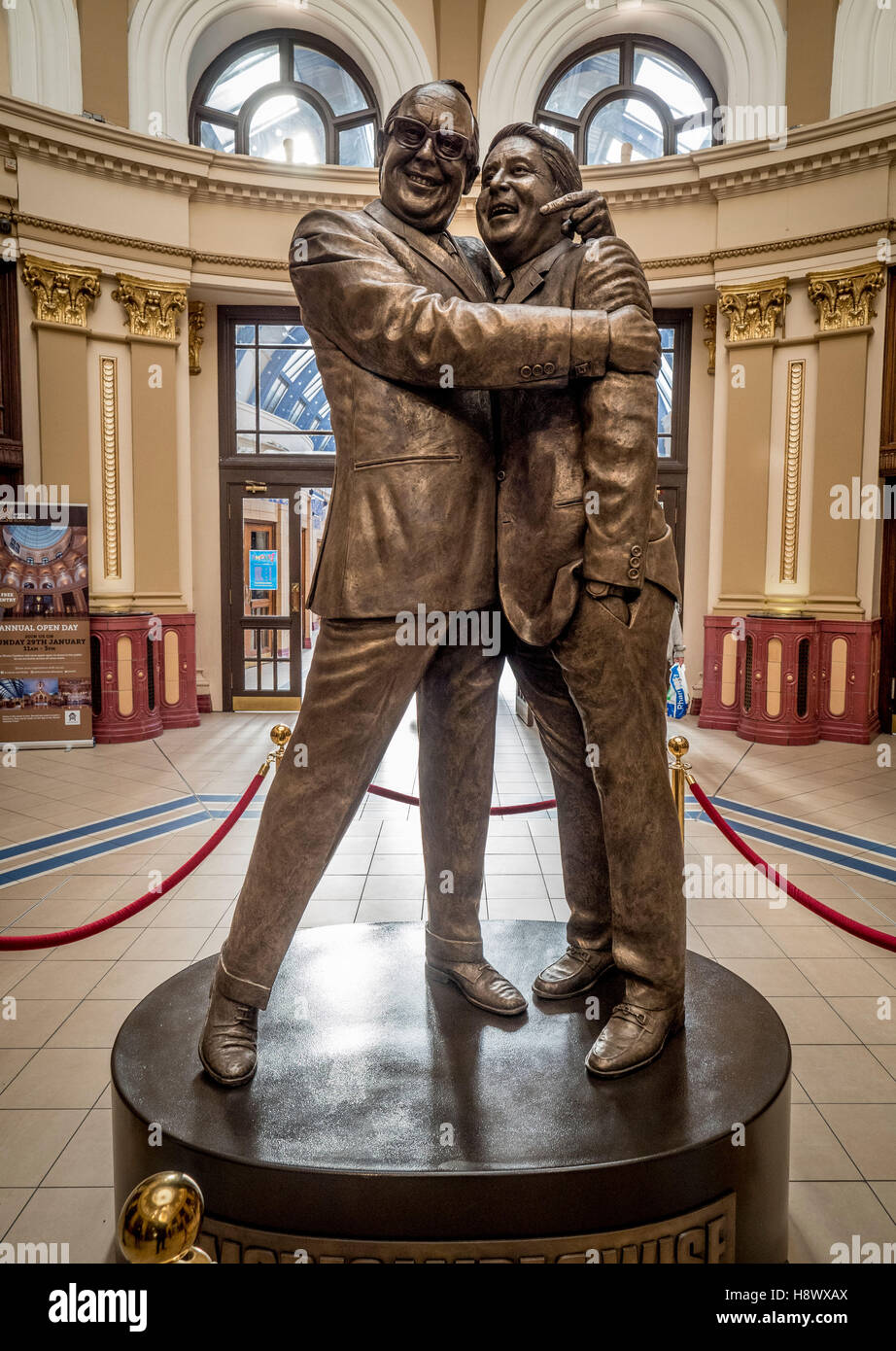 Statue of Eric Morecambe and Ernie Wise by Graham Ibbeson in the domed entrance of Blackpool's Winter Gardens, Lancashire, Stock Photo