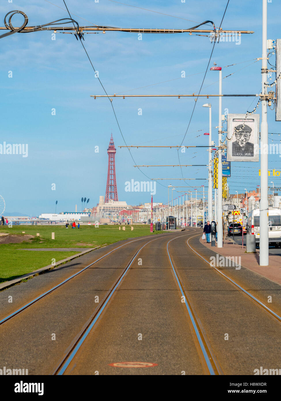 Tram tracks along seafront promenade with Tower in distance, Blackpool, Lancashire, UK. - Stock Image