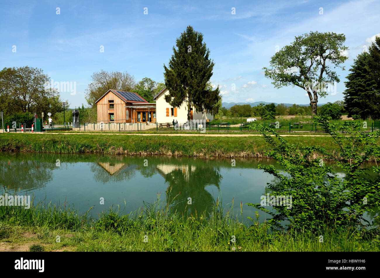 lock keeper house Canal de Huningue - Alsace France - Stock Image
