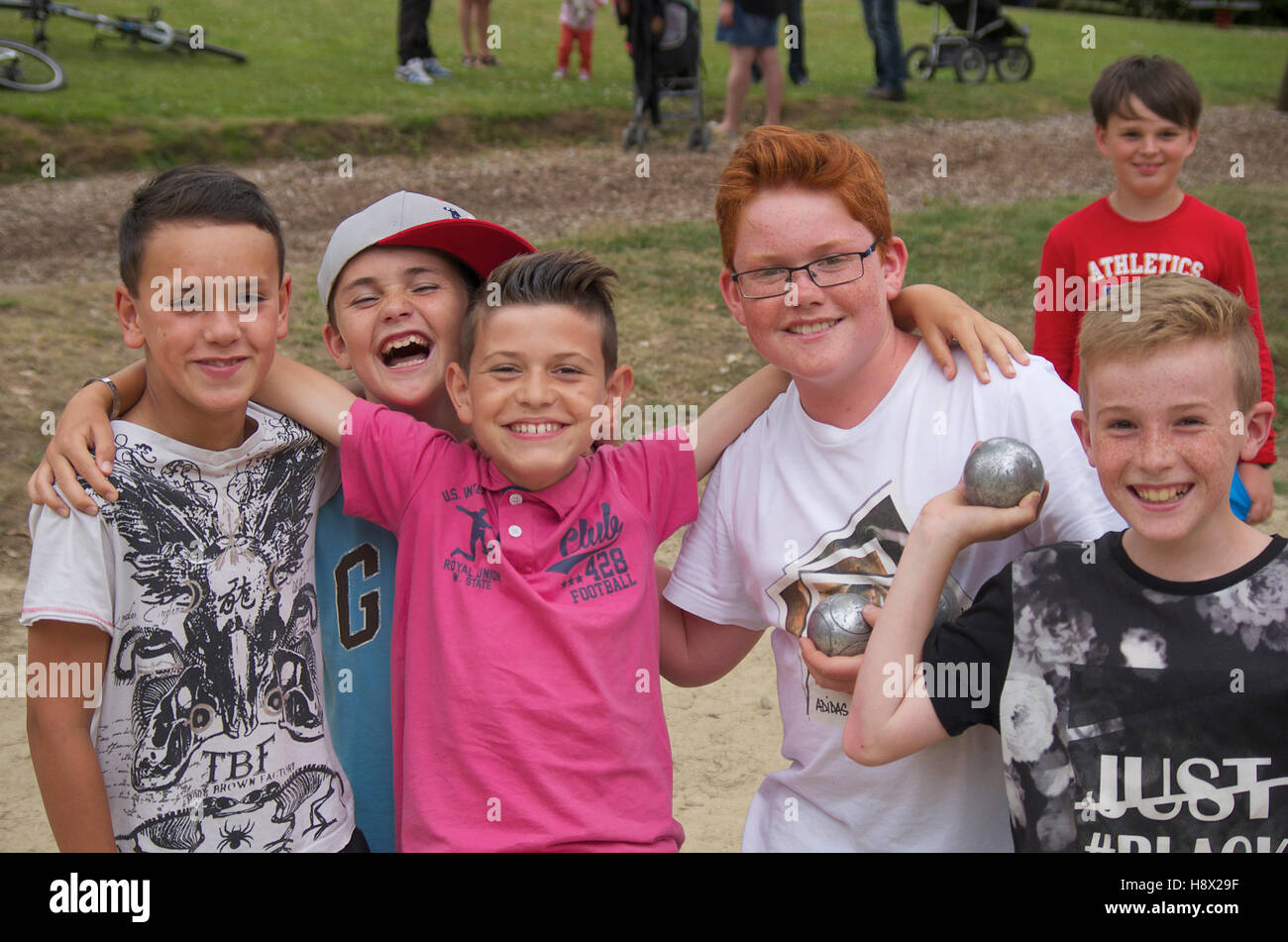 Group of happy Breton children at a petanque game - Stock Image