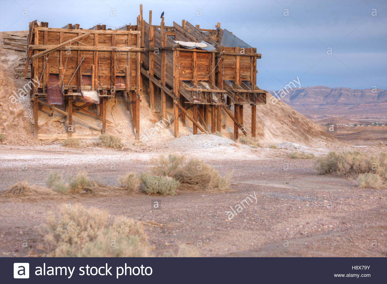 Remains of an inactive mine in the California desert. - Stock Image