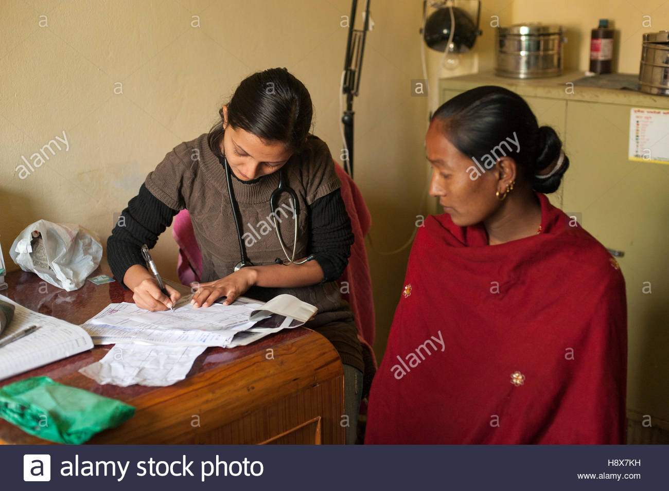 A General Practitioner consults a patient at a hospital in Nepal. Stock Photo