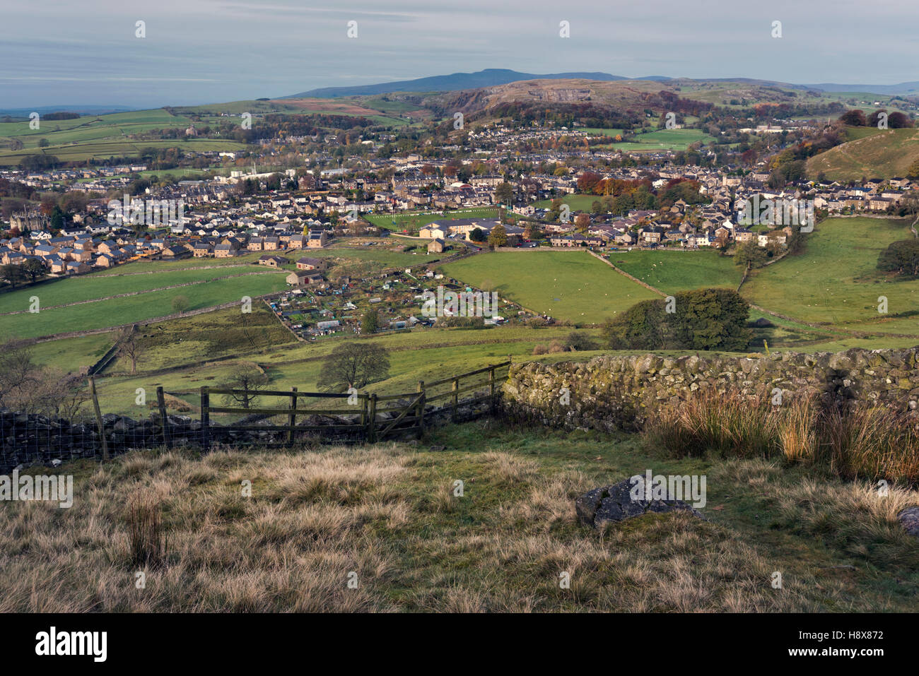 View over the market town of Settle and the village of Giggleswick, with Ingleborough hill on the horizon, North - Stock Image