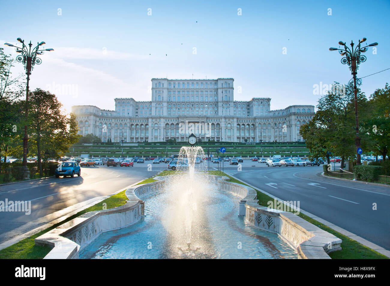 Bucharest Parliament with fountain in front of it. Romania - Stock Image