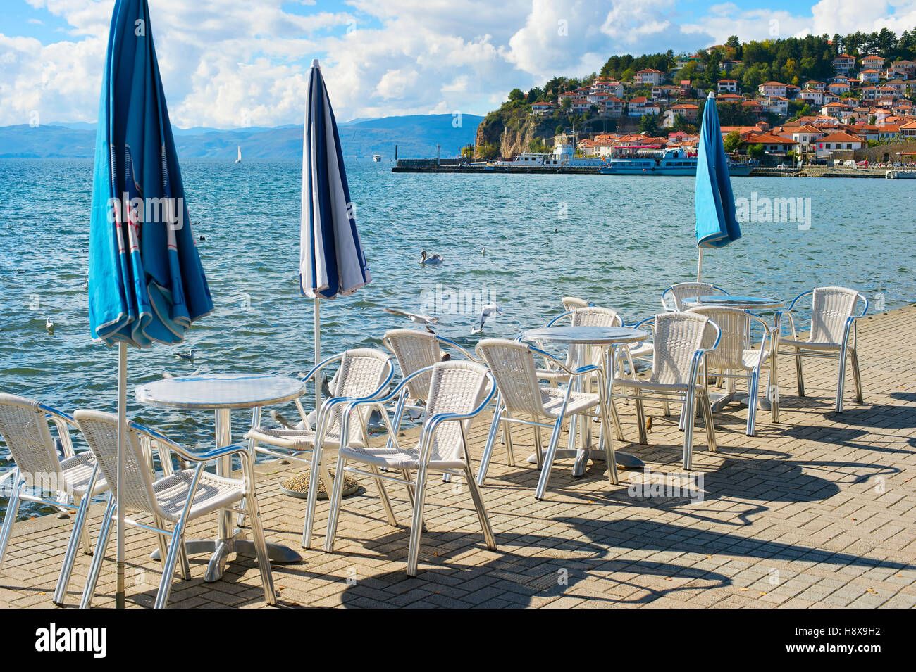 Restaurant on the embankment in the sunny day. Ohrid, Macedonia - Stock Image