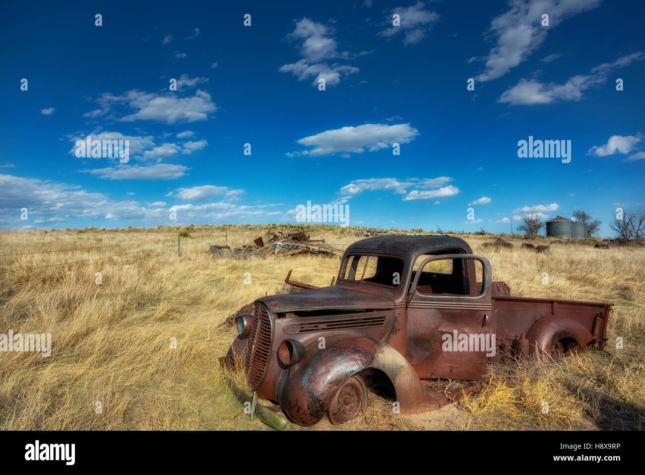Old abandoned rustic Ford pickup truck parked in a farmer\'s junk ...