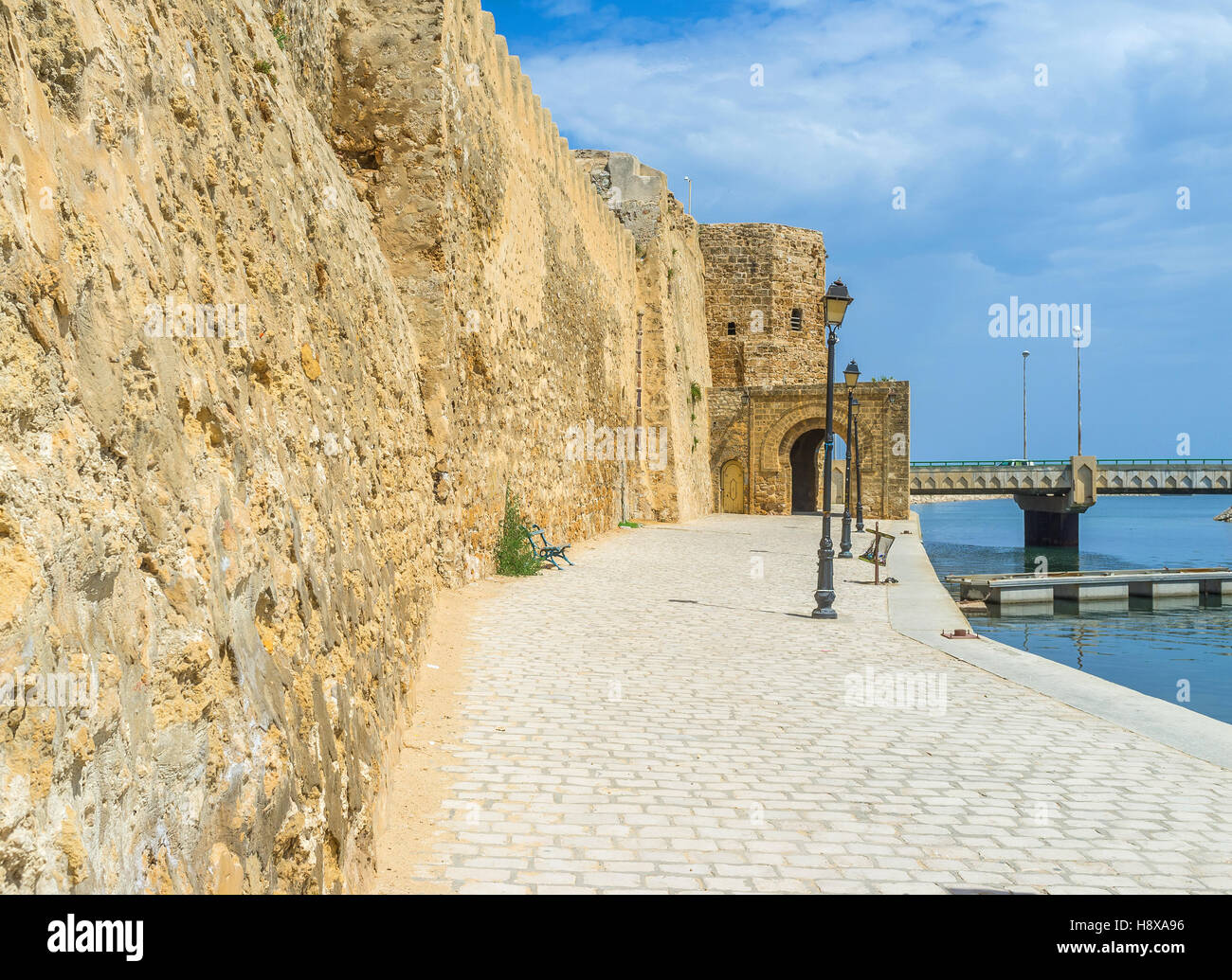 The stone rampart separates the old Medina from the fishing port, Bizerte, Tunisia. - Stock Image