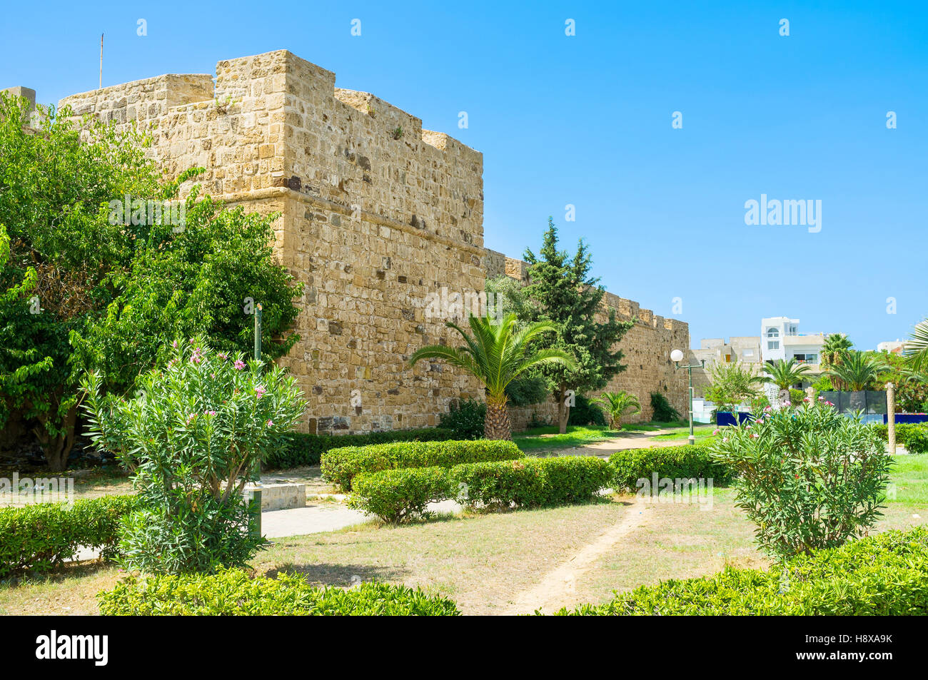 The lovely green garden next to the rampart of Kasbah, Bizerte, Tunisia. - Stock Image