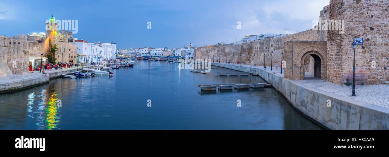 The fishing shipyard neighbors with the medieval citadel of Kasbah, Bizerte, Tunisia. - Stock Image