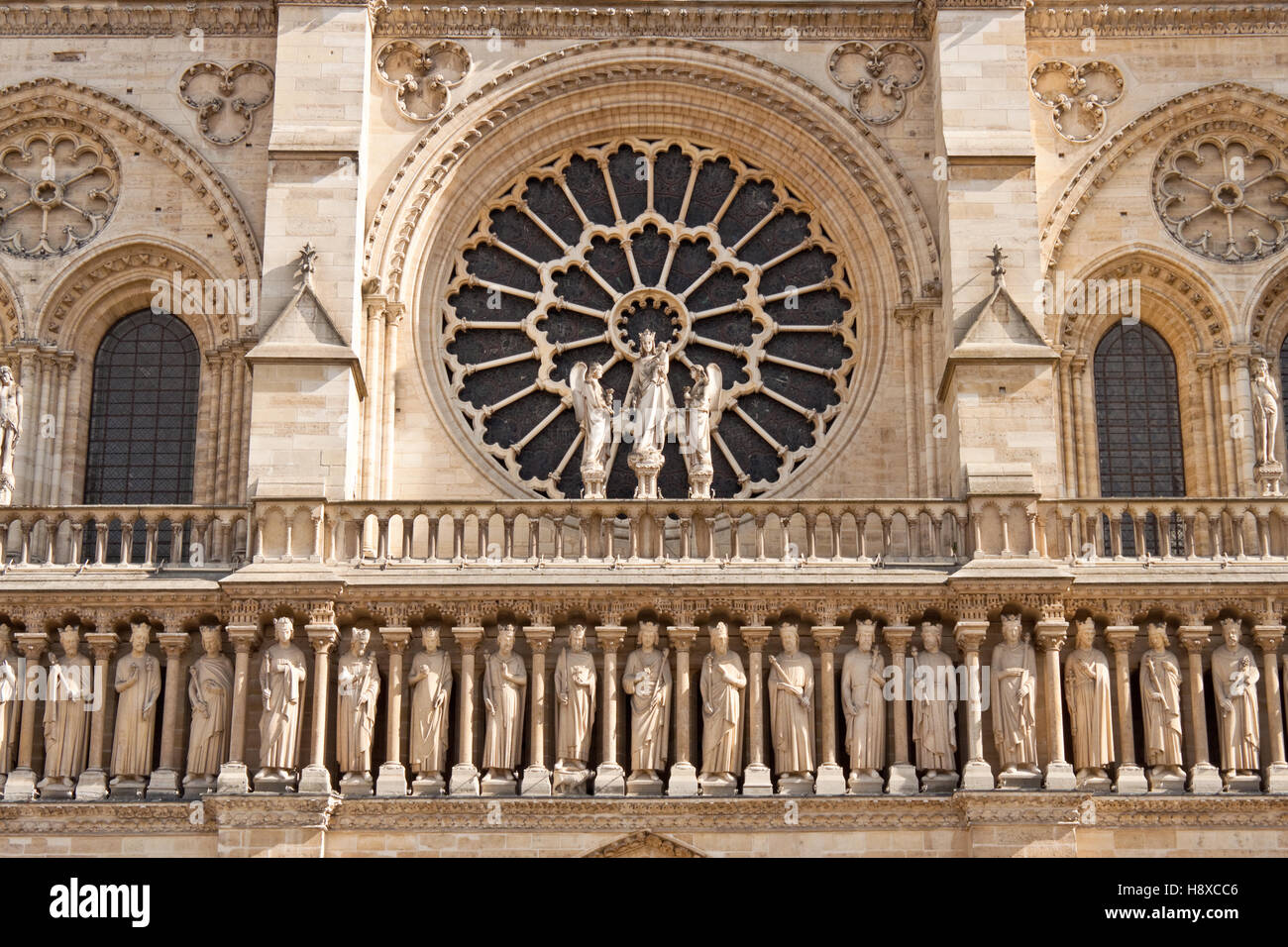 Closeup view of the Notre Dame de Paris Cathedral facade with kings' statues and rose window - Stock Image