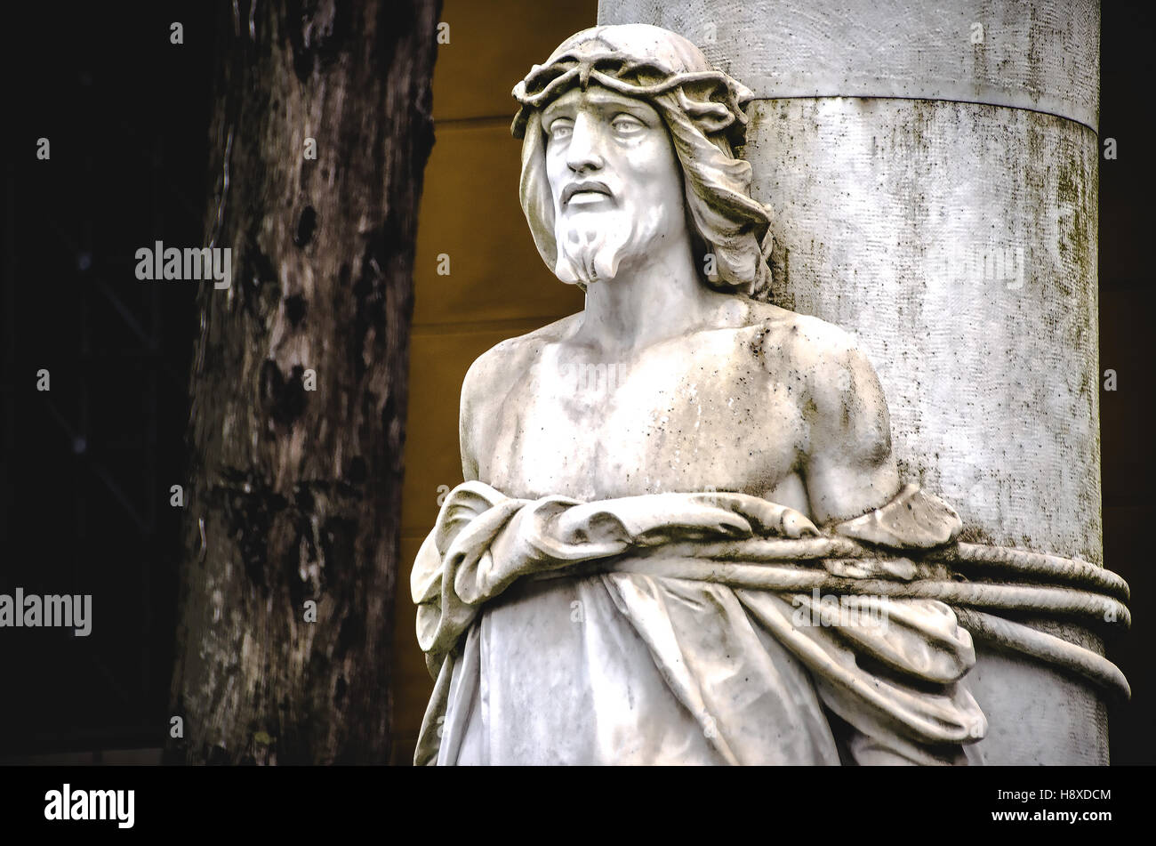 statue of Jesus Christ tied to a column in the Monumental Cemetery La Certosa of Bologna - Stock Image
