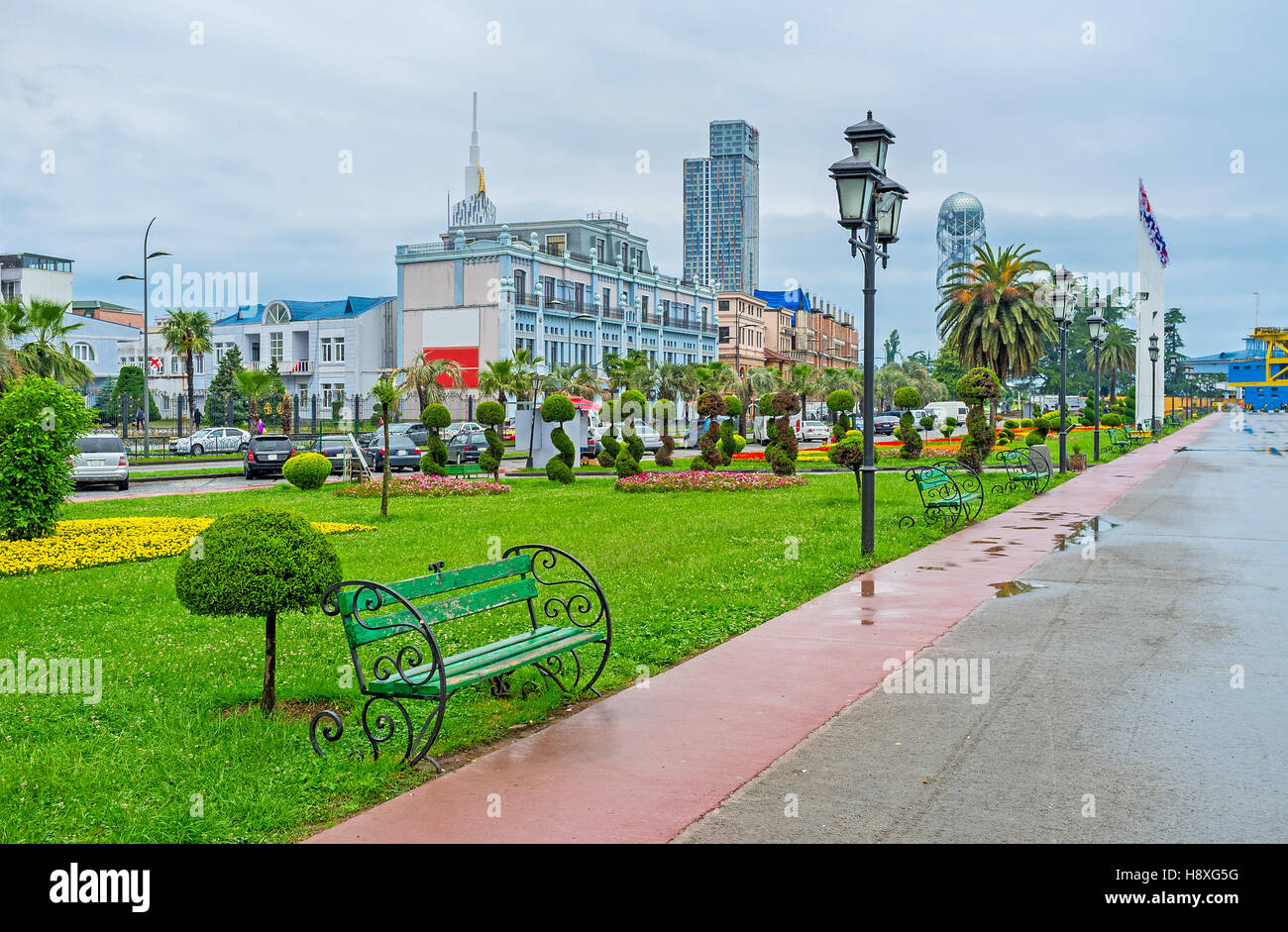 The nice landscaped french garden decorates the Sea Port promenade of Batumi, Georgia. - Stock Image