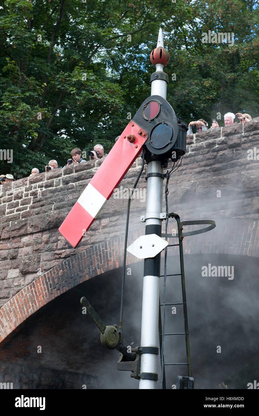 Lower quadrant semaphore starting signal at  on the West somerset Railway, UK Stock Photo