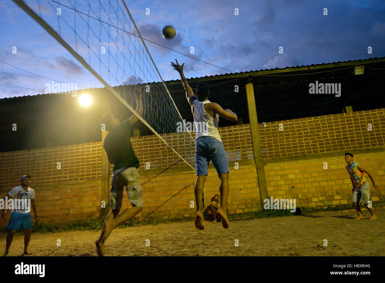 Young people playing volleyball, evening, Trinta, Itaituba District, Pará, Brazil - Stock Image