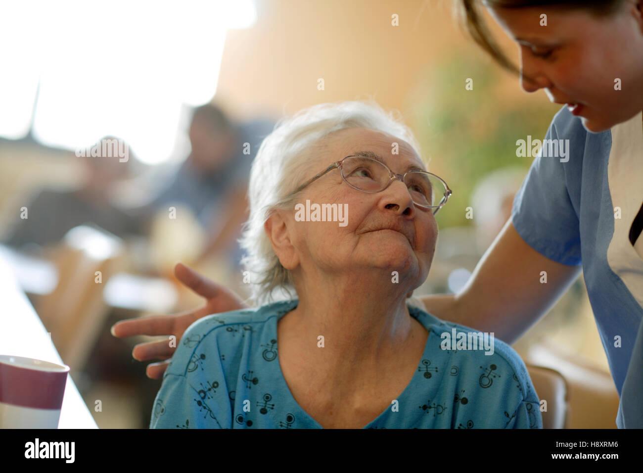 Nursing home, elderly woman with a nurse - Stock Image