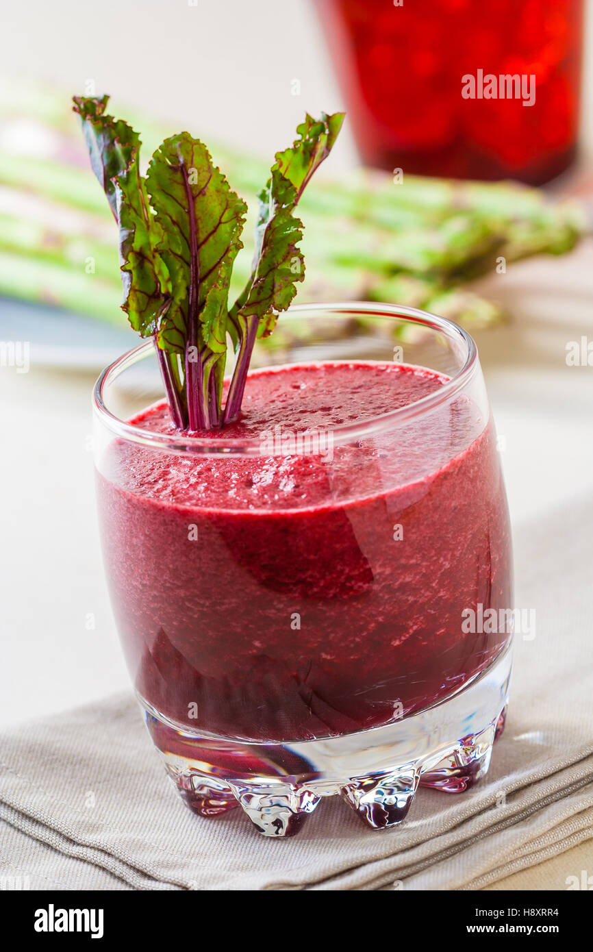 Fresh beet juice with leaves in a glass - Stock Image