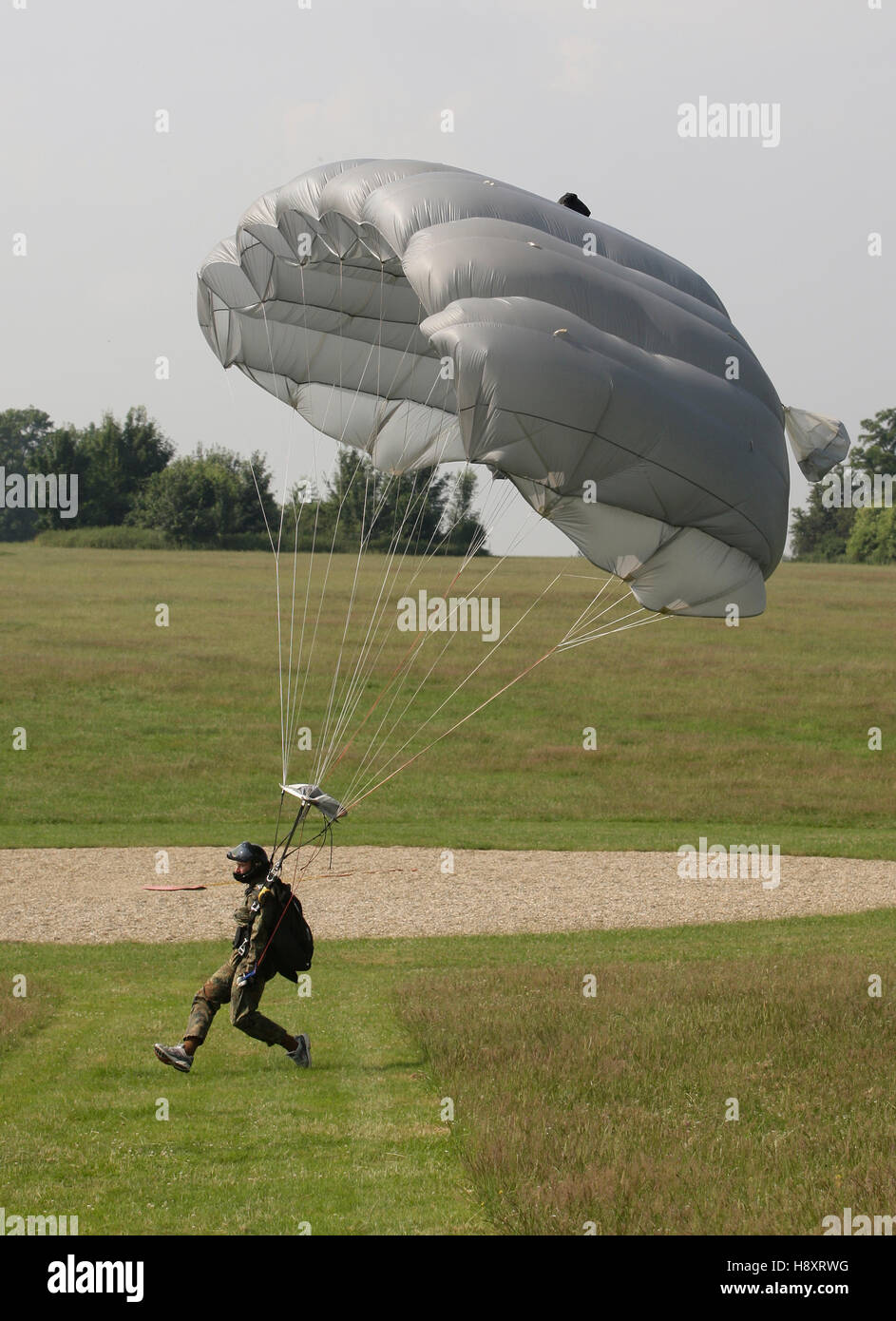 Paratrooper landing with a paraglider beside the target, 13th International Paratrooper Competition of the Special Stock Photo