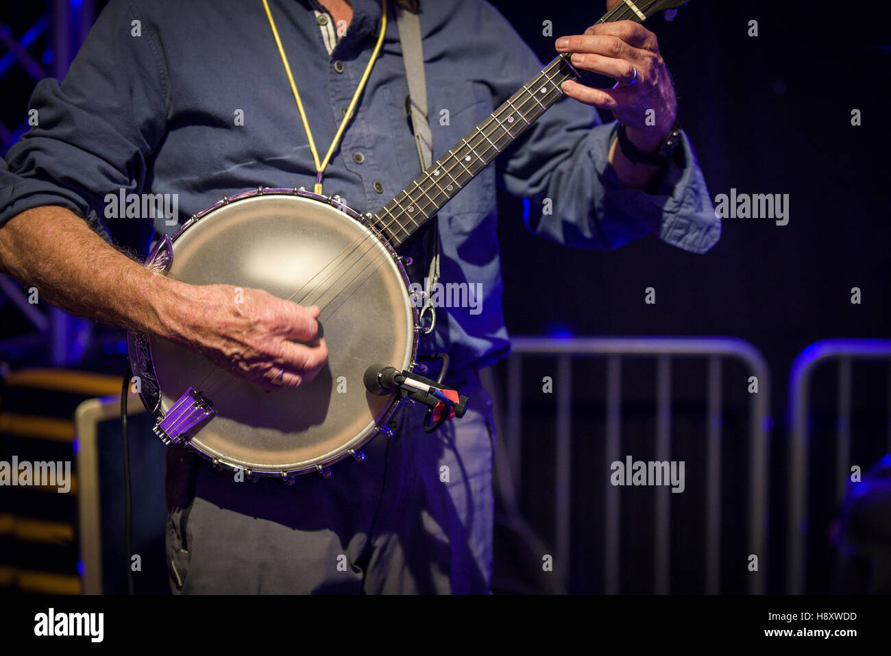 A banjo player performing. - Stock Image