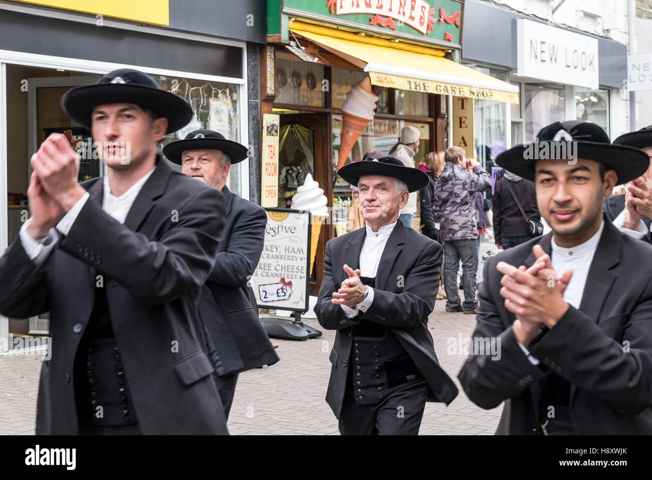 As part of Lowender Peran musicians and dancers parade through the town of Newquay, Cornwall. - Stock Image