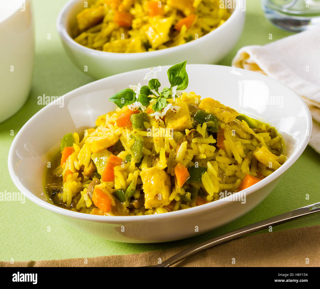 Curry rice with vegetables in a white bowl. - Stock Image